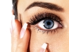 Details of beauty. French manicured nails and eye with ceremonial makeup